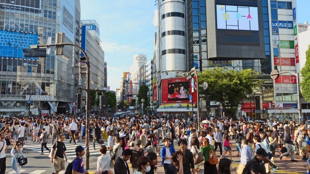 Crowd of Japanese people walking through the city