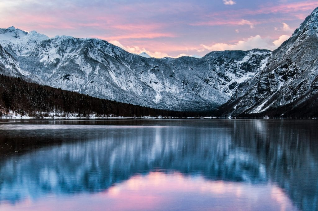 Reflective shot of mountains surrounding Lake Bled