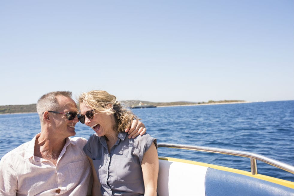 A couple on a boat trip in the Mediterranean