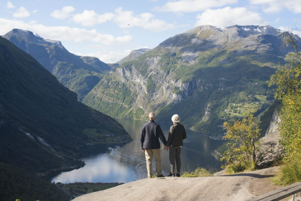 A couple overlooking a fjord in Norway