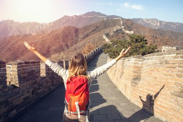 Reasons to visit China Woman-at-Great-Wall-of-China-www.istockphoto.com_gb_photo_young-woman-embracing-nature-great-wall-of-china-gm638807176-114768029-swissmediavision