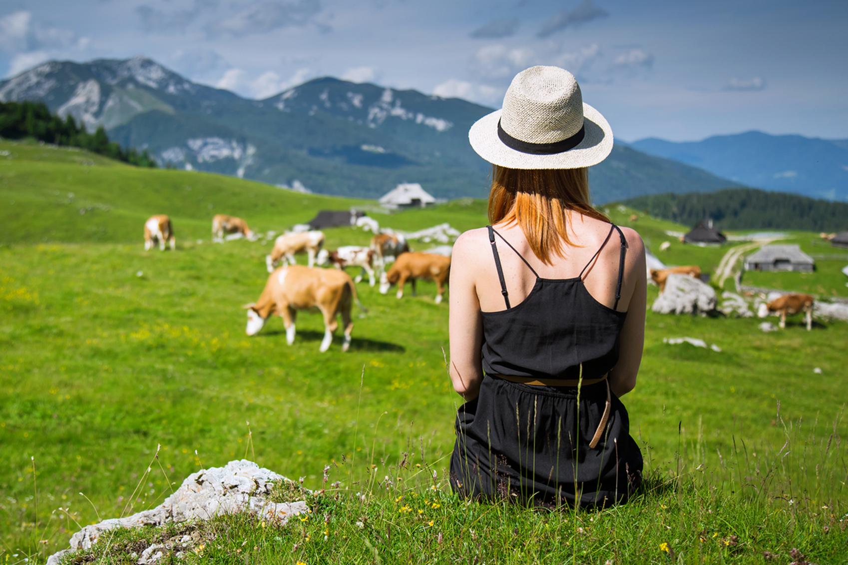Solo travel destinations Woman-enjoys-views-of-the-alpine-village-www.istockphoto.comgbphotowoman-enjoys-views-of-the-alpine-village-in-the-mountains-gm619272288-107972855-NataliaDeriabina