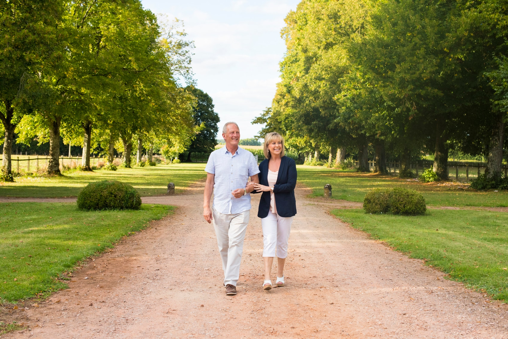 A couple walking through the gardens of Hôtel de Soubise in Paris a real Hidden Gem in Europe