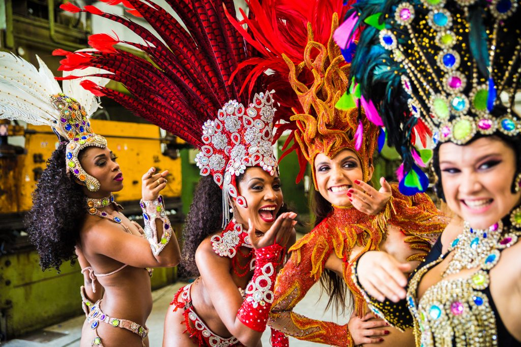 colourful festivals Rio-carnival-www.istockphoto.comgbphotobrazilian-women-wearing-carnival-costume-in-an-old-factory-gm905666874-249718763-filipefrazao