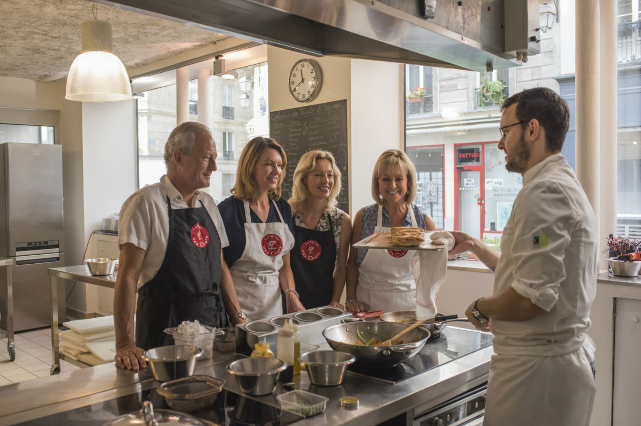 A group cooking with a Parisian chef