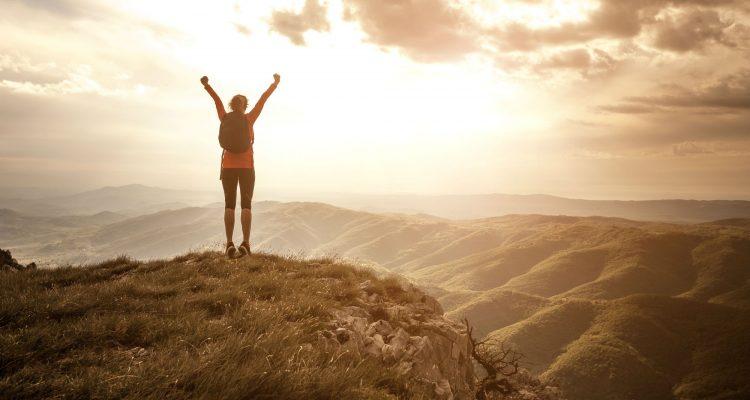 Women climbing hill