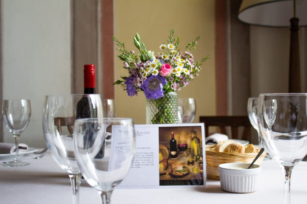Guests enjoy a multi-course Tuscan feast as part of their culinary tour in Tuscany.