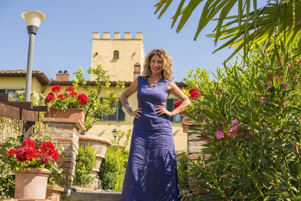 Giada Landi in front of her stunning villa in the Tuscan hills.