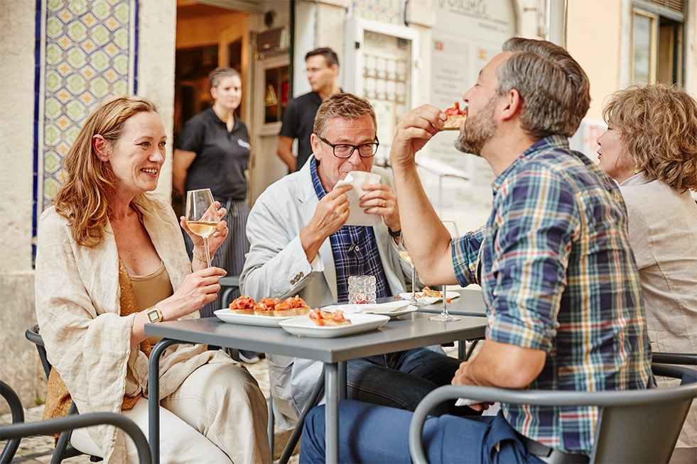 Trafalgar guests at a cafe in Europe
