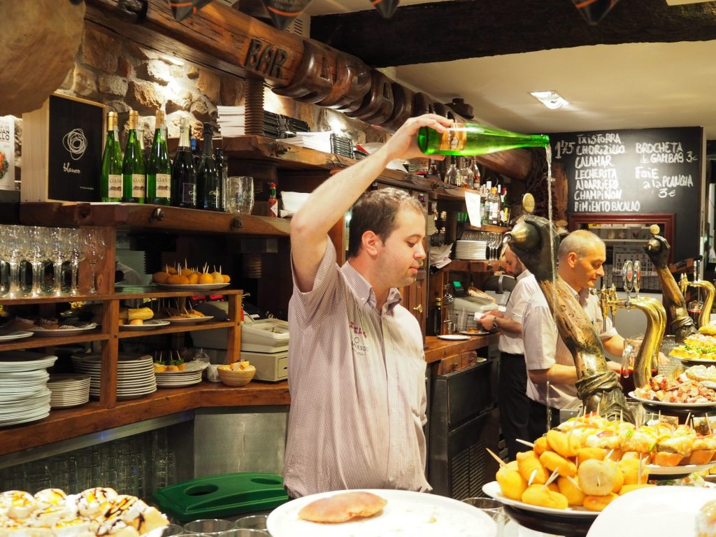 Man pouring cider in Asturias
