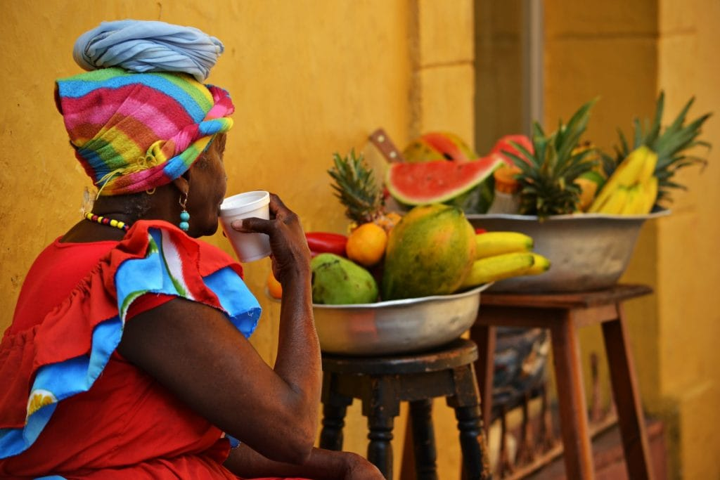 Woman drinking coffee in Cartagena Old Town