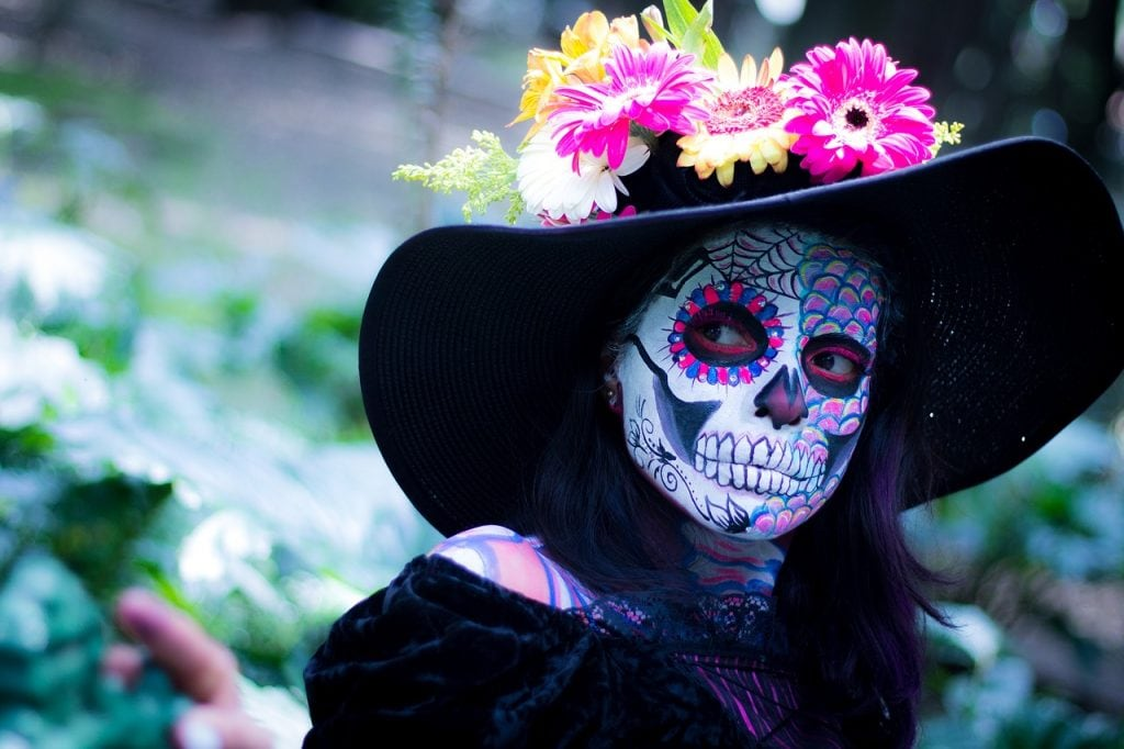 girl with painted skull face day of the dead tradition