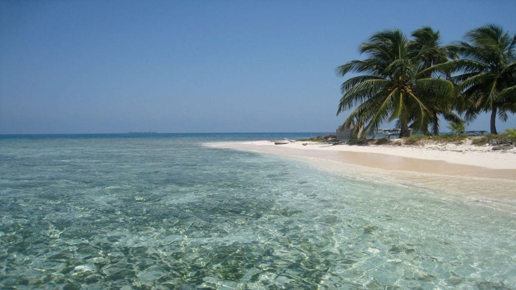 Crystal water white beach Placencia Belize