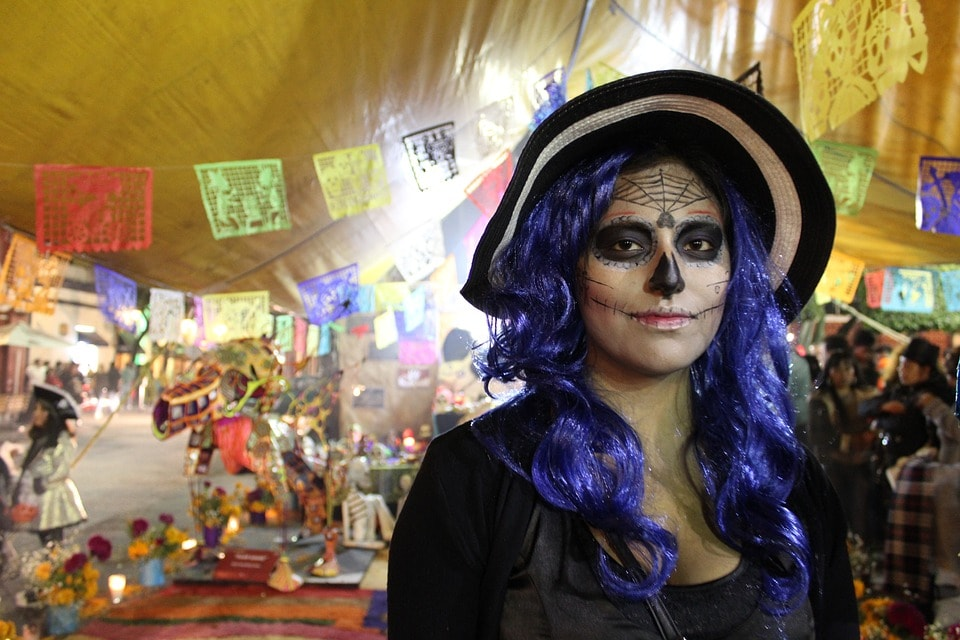 lady at day of the dead celebration in mexico