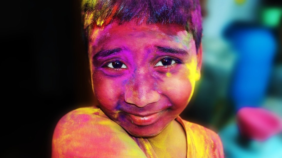 young boy at holi festival, india