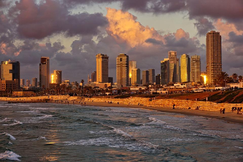 Tel Aviv beach with city skyline behind