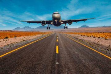 aeroplane landing desert road