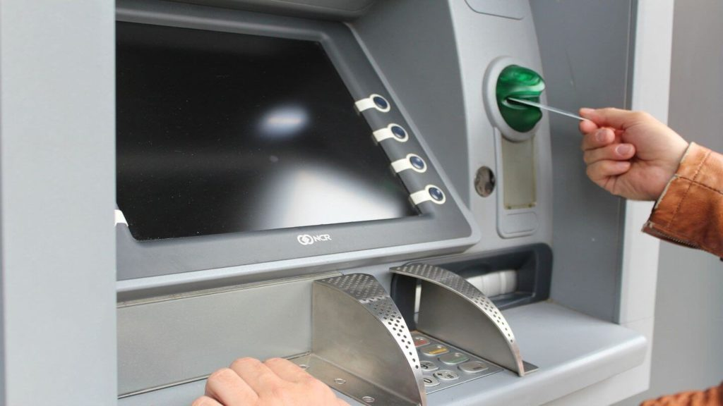 inserting card into ATM machine