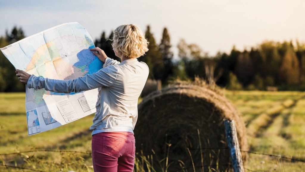 lost person looking at a map