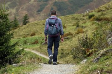 man walking hiking trail travel safety tips