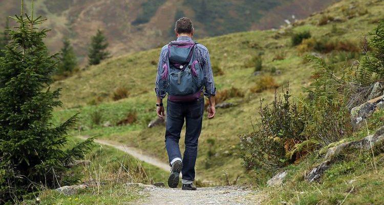 man walking hiking trail travel safety tips