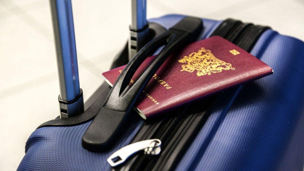 passport suitcase travel safety tips