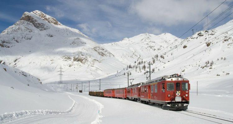 train travelling through snow switzerland