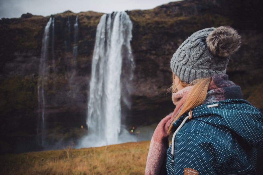 Lady exploring waterfalls in Iceland