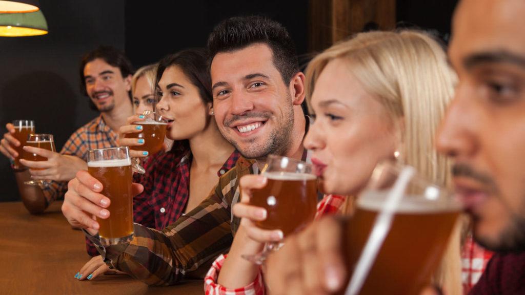 People in a bar drinking beer - Belarusian drinks