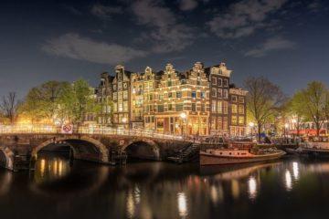 amsterdam bridge canals illuminated night