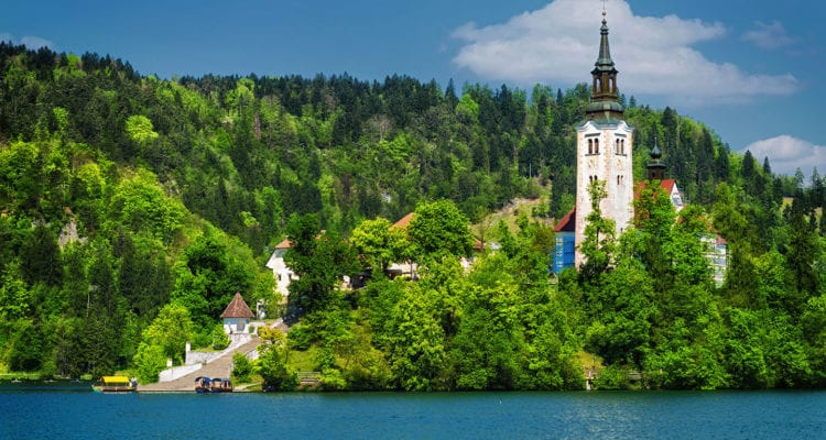 A church and a castle in lake bled