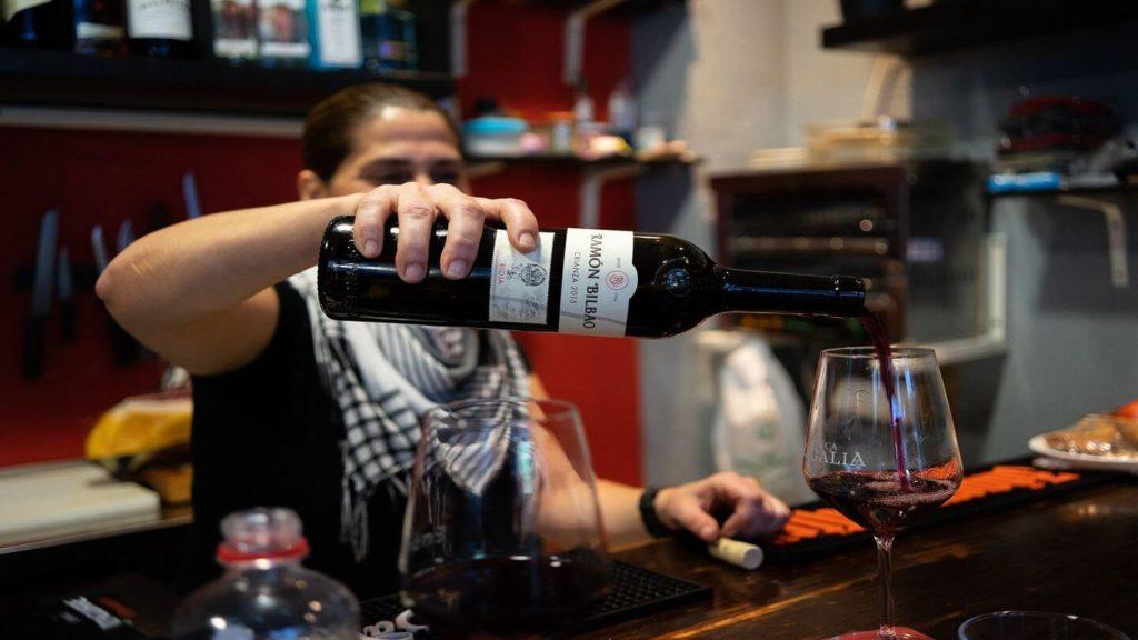 pouring wine tapas bar Spain