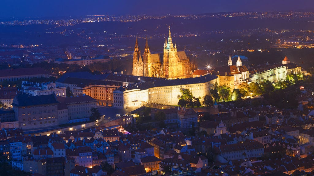 Aerial view by night of a castle in Prague - interesting Prague facts