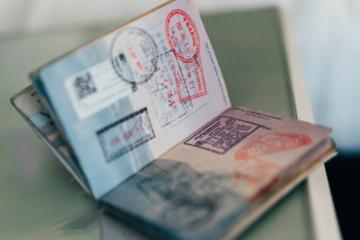 Passport stamps on an open passport