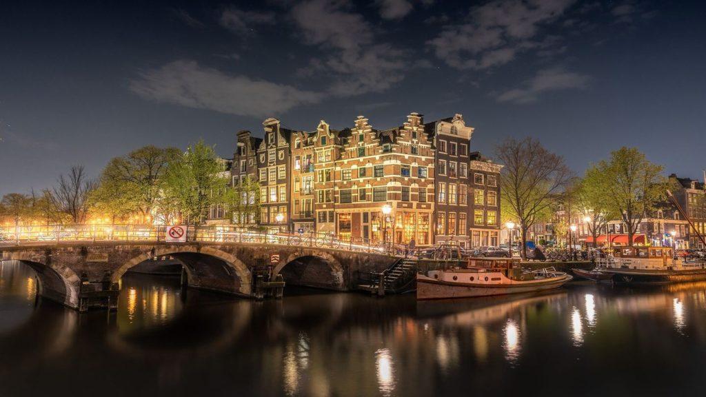 bridge illuminated night amsterdam netherlands