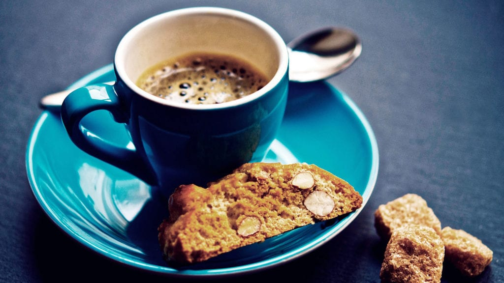 Espresso cup with a biscuit