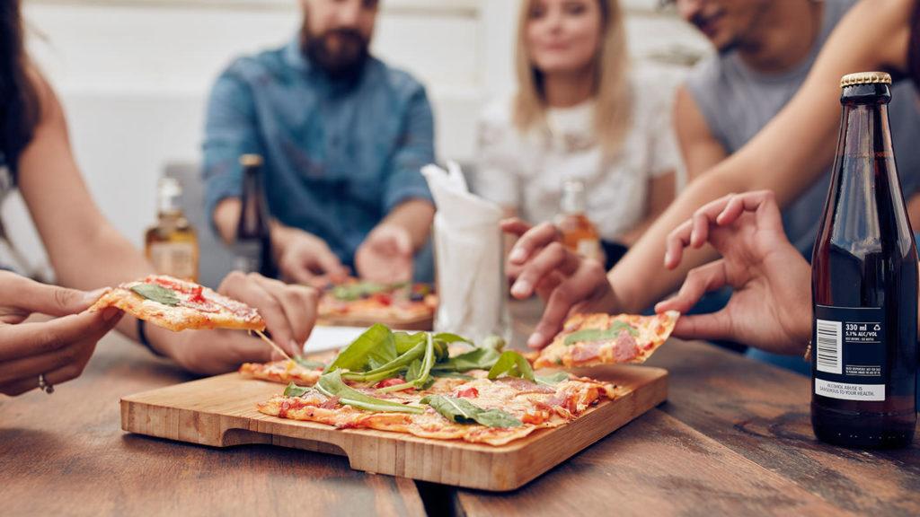 People eating pizza at Vaduz restaurants, cafés and bars