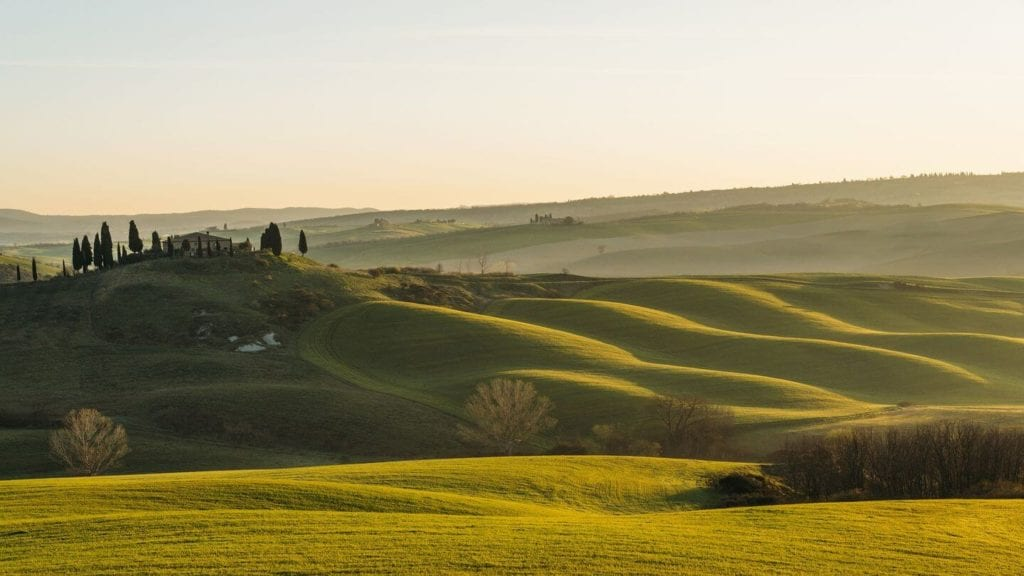 rolling green hills tuscany italy