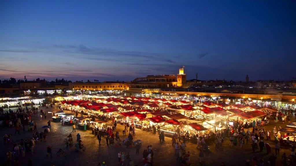 illuminated night market Marrakesh Morocco