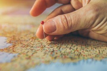 hand pinning travel map