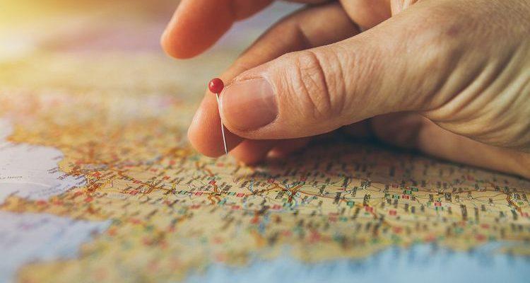 hand pinning travel map