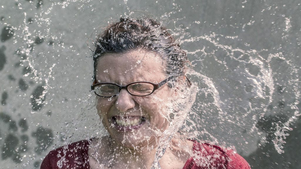 Woman splashed with waterr