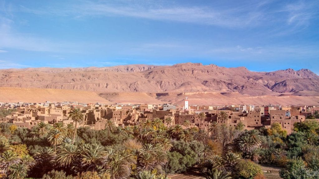 green trees brown mountains Tinghir oasis Morocco