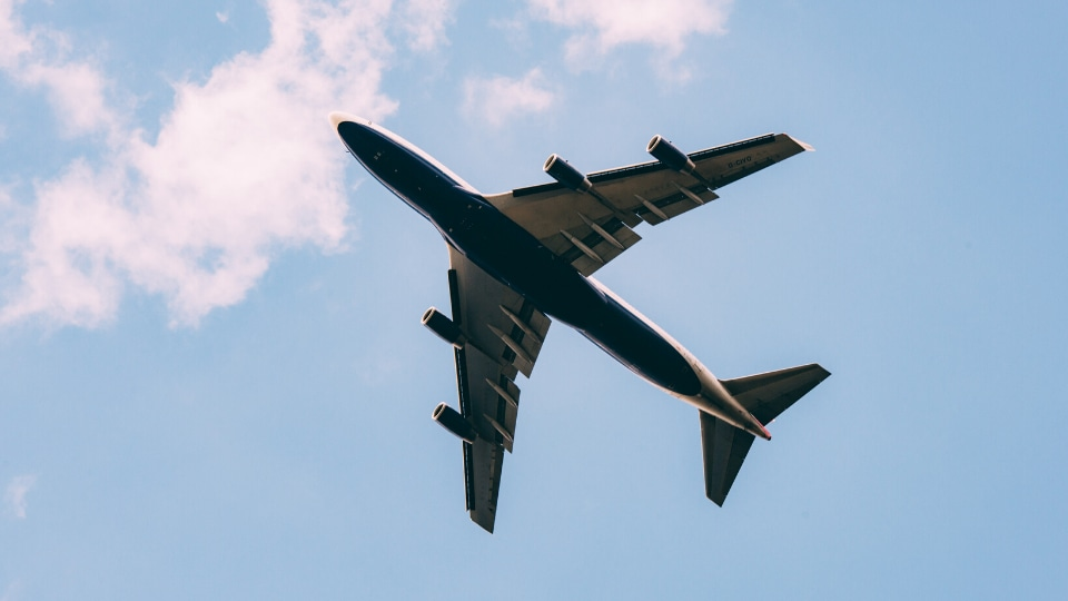 plane flying in front of blue sky