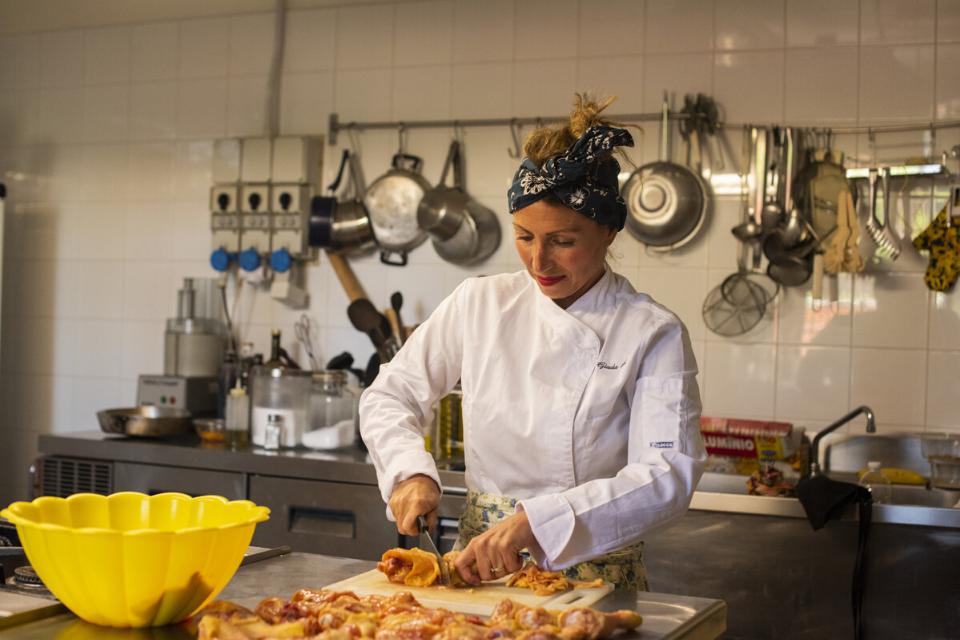 Giada Landi cooking food in her kitchen