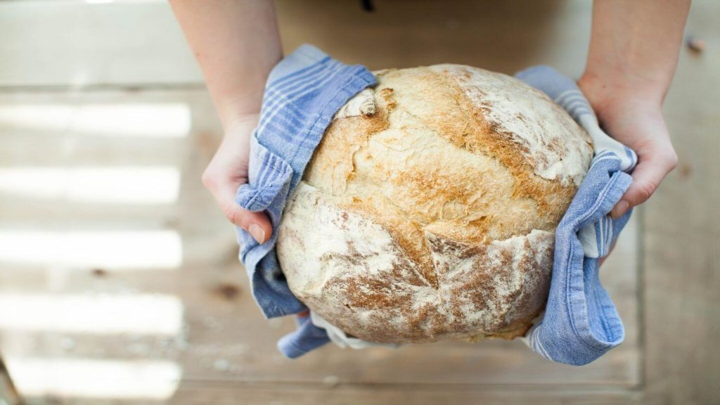 hands holding freshly baked bread