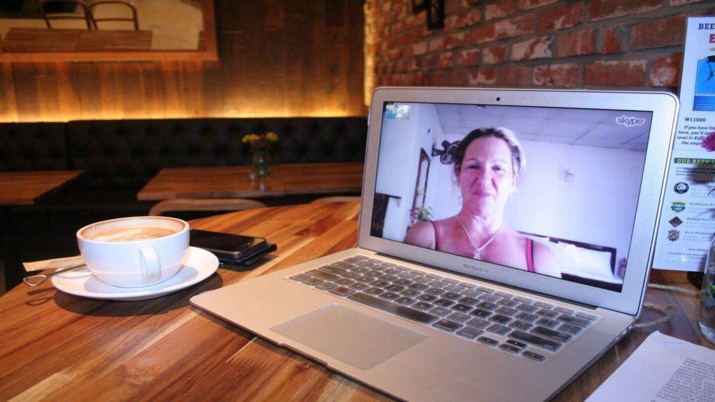 woman on Skype call laptop
