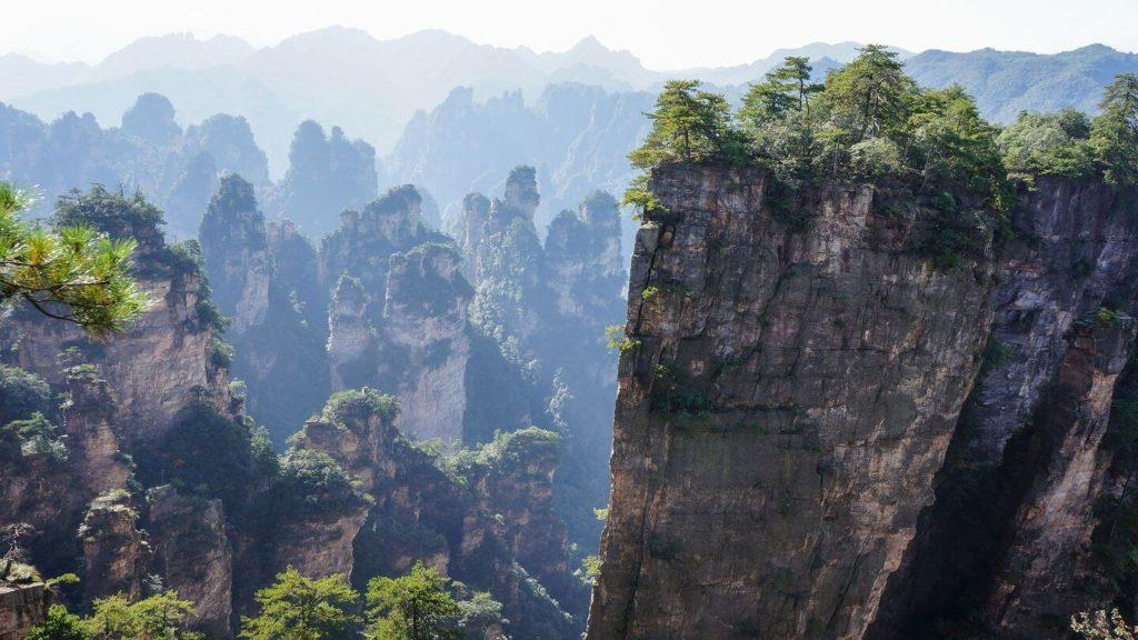 misty forested pillars Zhangjiajie China
