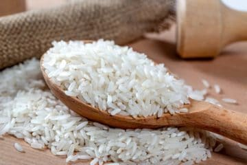 spoon of white rice grains