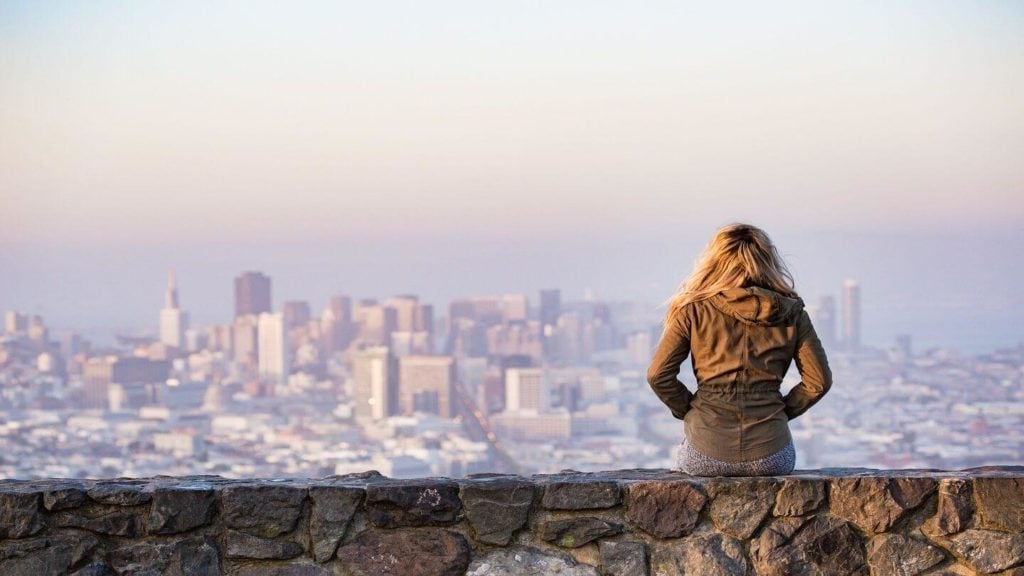 woman looking over san francisco city domestic travel